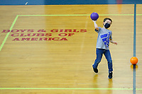 Liam Drenning, 7, plays inside the gymnasium with his classmates at the Boys and Girls Club of Western Pennsylvania in the Lawrenceville neighborhood on Friday February 19, 2021 in Pittsburgh, Pennsylvania. (Photo by Jared Wickerham/Pittsburgh City Paper)