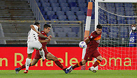Benevento s Gianluca Caprari, left, kicks the ball to score a goal during the Serie A soccer match between Roma and Benevento at Rome's Olympic Stadium, October 18, 2020.<br /> UPDATE IMAGES PRESS/Riccardo De Luca