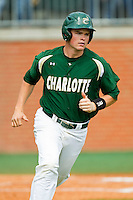Brett Lang (6) of the Charlotte 49ers hustles down the first base line against the Virginia Commonwealth Rams at Robert and Mariam Hayes Stadium on March 30, 2013 in Charlotte, North Carolina.  The 49ers defeated the Rams 9-8 in game one of a double-header.  (Brian Westerholt/Four Seam Images)