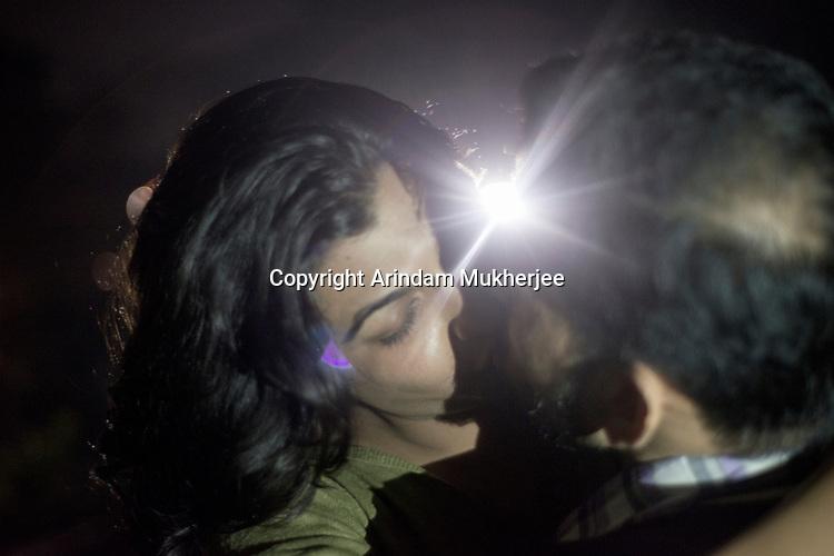 Dipmalya(Diya) kisses Saswata at their rooftop in Kolkata, West Bengal, India. Arindam Mukherjee
