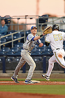 Indiana State Sycamores first baseman Jeff Zahn (35) stretches for a throw as Tyler Green (55) runs through the bag during a game against the Vanderbilt Commodores on February 20, 2015 at Charlotte Sports Park in Port Charlotte, Florida.  Vanderbilt defeated Indiana State 3-2.  (Mike Janes/Four Seam Images)