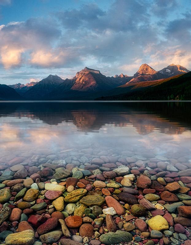 Lake McDonald with colorful rocks and sunset. Glacier National Park, Montana.