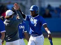 IMG Academy Ascenders Elijah Green (2) high fives teammates after scoring a run during a game against the Lakeland Dreadnaughts on February 20, 2021 at IMG Academy in Bradenton, Florida.  (Mike Janes/Four Seam Images)