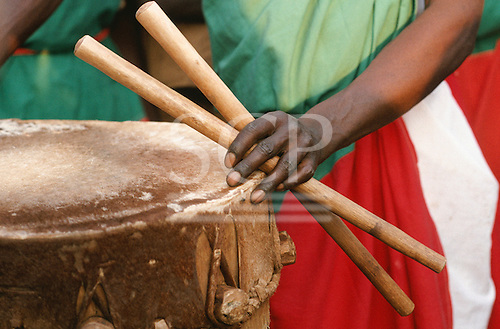 Burundi. Drummer's hand holding drum sticks and drum from a traditional Burundi group.
