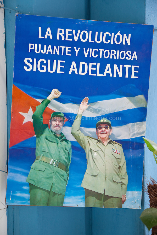 """Cuba, Havana.  Political Poster Commemorating the Transfer of Power from Fidel to Raul Castro.  """"The Revolution, Strong and Victorious, Continues Onward."""""""