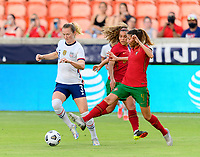 HOUSTON, TX - JUNE 10: Silvia Rebelo #4 of Portugal attempts to strip the ball from Samantha Mewis #3 of the United States during a game between Portugal and USWNT at BBVA Stadium on June 10, 2021 in Houston, Texas.