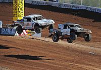 Dec. 10, 2011; Chandler, AZ, USA;  LOORRS pro 4 unlimited driver Josh Merrell (22) and Carl Renezeder (17) during round 15 at Firebird International Raceway. Mandatory Credit: Mark J. Rebilas-