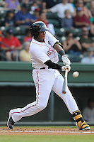 Infielder Mario Martinez (10) of the Greenville Drive bats in a game against the Charleston RiverDogs on Wednesday, June 12, 2013, at Fluor Field at the West End in Greenville, South Carolina.The teams wore their Boston and New York affiliate uniforms as part of a promotion. (Tom Priddy/Four Seam Images)