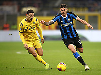 Calcio, Serie A: Inter Milano - Hellas Verona, Giuseppe Meazza stadium, November 9, 2019.<br /> Inter's Alessandro Bastoni (r) in action with Koray Gunter  (l) during the Italian Serie A football match between Inter and Hellas Verona at Giuseppe Meazza (San Siro) stadium, on November 9, 2019.<br /> UPDATE IMAGES PRESS/Isabella Bonotto