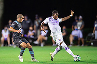 LAKE BUENA VISTA, FL - AUGUST 06: Andres Perea #21 of Orlando City SC kicks the ball during a game between Orlando City SC and Minnesota United FC at ESPN Wide World of Sports on August 06, 2020 in Lake Buena Vista, Florida.