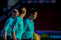 Referee Andrew Madley leads referees assistant Robert Merchant and referees assistant Neil Davies out during the Sky Bet Championship match between Barnsley and Leeds United at Oakwell, Barnsley, England on 25 November 2017. Photo by Stephen Buckley / PRiME Media Images