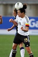 US's Kelley O'Hara heads the ball next Germany's Celia Okoyino Da Mbabi during their Algarve Women's Cup soccer match at Algarve stadium in Faro, March 13, 2013.  .Paulo Cordeiro/ISI