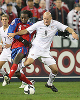Conor Casey #8 of the USA battles with Denis Marshall #5 of Costa Rica during a 2010 World Cup qualifying match in the CONCACAF region at RFK Stadium on October 14 2009, in Washington D.C.The match ended in a 2-2 tie.