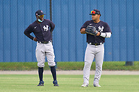 New York Yankees outfielders D'Vaughn Knowles (11) and Jasson Dominguez (25) during warmups before an Extended Spring Training game against the Detroit Tigers on June 19, 2021 at the Joker Marchant Stadium in Lakeland, Florida.  (Mike Janes/Four Seam Images)