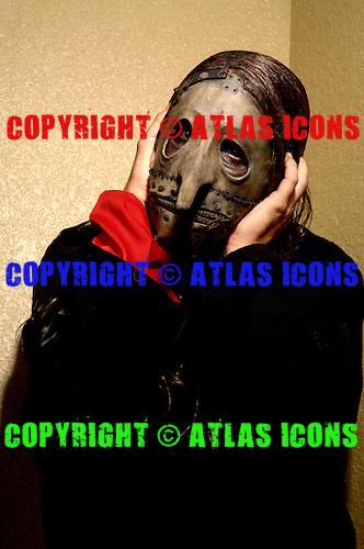 (#3) Chris Fehn – custom percussion, backing vocals , .Slipknot Studio Portrait Session In Desmoines Iowa.Photo Credit: Eddie Malluk/Atlas Icons.com