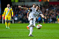 Swansea, UK. Thursday 20 February 2014<br /> Pictured: Swansea defender Chico Flores takes a shot at goal<br /> Re: UEFA Europa League, Swansea City FC v SSC Napoli at the Liberty Stadium, south Wales, UK