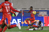 Harrison, NJ - Thursday March 01, 2018: Kevin Álvarez, Kemar Lawrence. The New York Red Bulls defeated C.D. Olimpia 2-0 (3-1 on aggregate) during a 2018 CONCACAF Champions League Round of 16 match at Red Bull Arena.