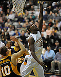 13 December 2008: Albany's Scotty McRae lays a shot off the glass during a game between Canisius and Albany won by Albany 74-46 at SEFCU Arena in Albany, New York.