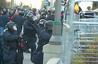 OTTAWA , November 17th 2001 FILE PHOTO<br /> <br /> A  Policeman in riot gear (R)  use a tear gas grenade launcher while another policeman (L) get ready to use pepper spray against some demonstrators inside the security perimeter, during the Summit of G-20 Countries in Ottawa on Saturday, November 17, 2001.<br /> <br /> The  G-20 meeting , where central bank chiefs and finance ministers from rich and poor nations discuss topics such as ; terrorism funding, economy slowdown and 3rd world nation's debt was initially scheduled for september in India,but  postponed  to  November 16th to 18th, 2001 and is beeing hosted by G-20 Chair ;  Canada Minister of Finance ;  Paul Martin.