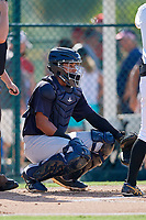 GCL Yankees West catcher Hemmanuel Rosario (21) gives the signs during a game against the GCL Pirates on August 2, 2018 at Pirate City Complex in Bradenton, Florida.  GCL Pirates defeated GCL Yankees West 6-2.  (Mike Janes/Four Seam Images)