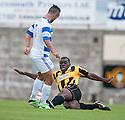 East Fife's Joe Mbu clears from Morton's Dougie Imrie.