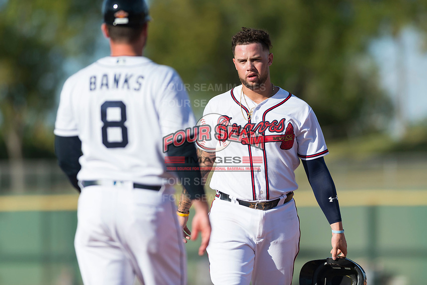 Peoria Javelinas first baseman Braxton Davidson (34), of the Atlanta Braves organization, and hitting coach Doug Banks (8) between innings of the Arizona Fall League Championship game against the Salt River Rafters at Scottsdale Stadium on November 17, 2018 in Scottsdale, Arizona. Peoria defeated Salt River 3-2 in 10 innings. (Zachary Lucy/Four Seam Images)