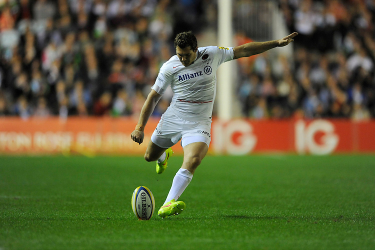 Alex Goode of Saracens takes a penalty kick during the Premiership Rugby Round 2 match between Harlequins and Saracens at The Twickenham Stoop on Friday 12th September 2014 (Photo by Rob Munro)