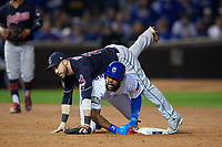 Cleveland Indians second baseman Jason Kipnis (22) and base runner Jason Heyward (22) look to first base after colliding during a double play in the second inning during Game 4 of the Major League Baseball World Series against the Chicago Cubs on October 29, 2016 at Wrigley Field in Chicago, Illinois.  (Mike Janes/Four Seam Images)