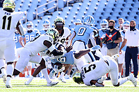 CHAPEL HILL, NC - NOVEMBER 14: Michael Carter #8 of North Carolina is tackled by Ryan Smenda Jr. #5 and Ja'Cquez Williams #8 of Wake Forest during a game between Wake Forest and North Carolina at Kenan Memorial Stadium on November 14, 2020 in Chapel Hill, North Carolina.