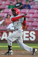 Spokane Indians outfielder Guillermo Pimentel #31 bats against the Salem-Keizer Volcanoes at Volcanoes Stadium on August 10, 2011 in Salem-Keizer,Oregon. Salem-Keizer defeated Spokane 7-6.(Larry Goren/Four Seam Images)