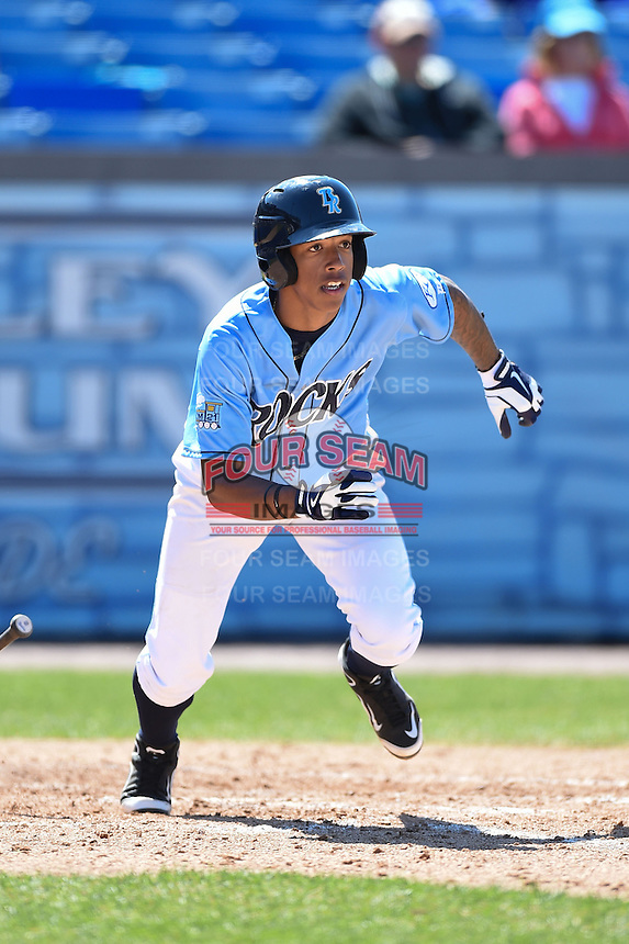 Wilmington Blue Rocks shortstop Raul Mondesi (7) runs to first after hitting a triple during a game against the Myrtle Beach Pelicans on April 27, 2014 at Frawley Stadium in Wilmington, Delaware.  Myrtle Beach defeated Wilmington 5-2.  (Mike Janes/Four Seam Images)