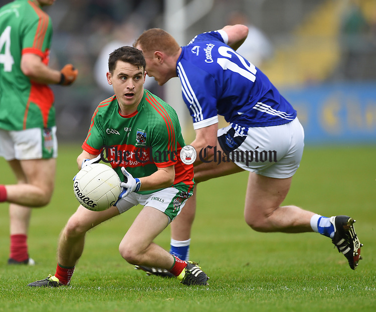 Martin Mc Mahon of  Kilmurry Ibrickane in action against Conor Cooney of Cratloe during their senior football final replay at Cusack park. Photograph by John Kelly.