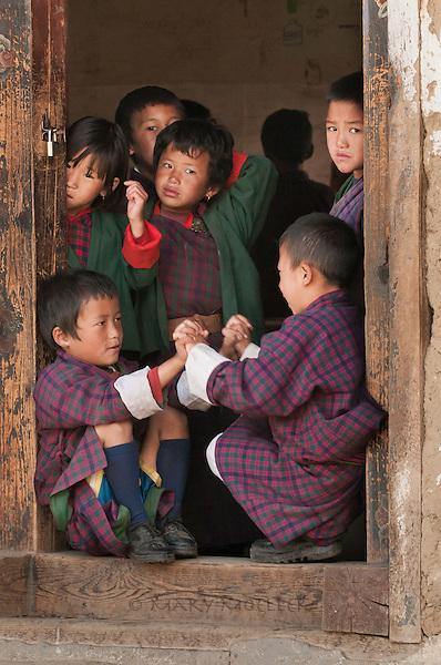 School boys after class dressed in their native garb.<br /> Bhutan 10/2012