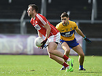 Paul Kerrigan of Cork in action against Dean Ryan of Clare during their National Football League game at Cusack Park. Photograph by John Kelly.