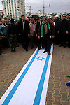 A Palestinian Hamas leader, Mahmoud al-Zahar walks on an Israeli flag as part of a rally marking the 2nd anniversary of Israeli war on Gaza Strip, in Gaza City on January 1, 2011. Photo by Mohammed Asad