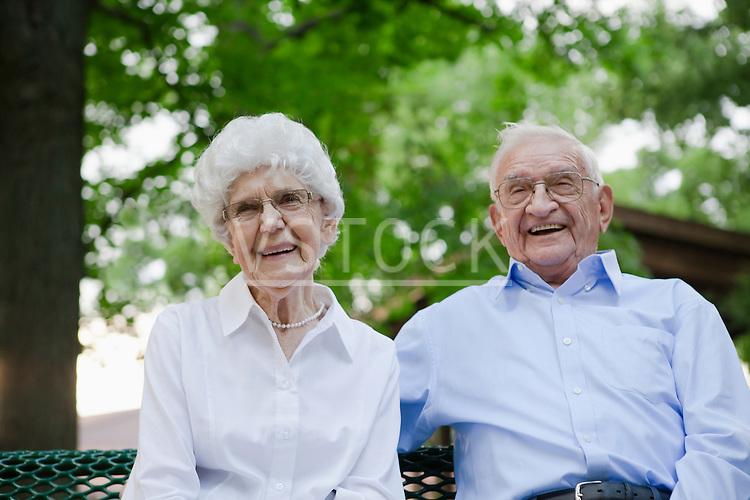 USA, Illinois, Metamora, Portrait of senior couple in sitting on bench park