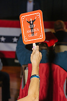 """A woman holds a fan featuring an image of Donald Trump and the slogan """"Keep America Great"""" while Eric Trump, son of US president Donald Trump, speaks during a Make America Great Again! campaign rally at the DoubleTree by Hilton Manchester Downtown in Manchester, New Hampshire, on Mon., Oct. 19, 2020. The audience chairs are distanced to follow safety protocols during the ongoing Coronavirus (COVID-19) global pandemic, just a few weeks after Donald Trump himself contracted the disease, though many other Trump campaign events are lax about COVID safety protocols."""