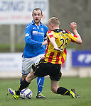 St Johnstone v Partick Thistle...29.03.14    SPFL<br /> Dave Mackay is tackled by Chris Erskine<br /> Picture by Graeme Hart.<br /> Copyright Perthshire Picture Agency<br /> Tel: 01738 623350  Mobile: 07990 594431