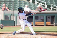 Salt River Rafters right fielder Jaylin Davis (30), of the Minnesota Twins organization, follows through on his swing during an Arizona Fall League game against the Surprise Saguaros at Salt River Fields at Talking Stick on November 5, 2018 in Scottsdale, Arizona. Salt River defeated Surprise 4-3 . (Zachary Lucy/Four Seam Images)