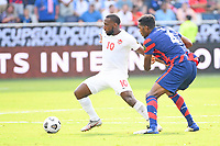 KANSAS CITY, KS - JULY 18: Junior Hoilett #10 of Canada ,Donovan Pines #4 of the United States during a game between Canada and USMNT at Children's Mercy Park on July 18, 2021 in Kansas City, Kansas.
