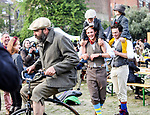 Pic shows: The Tweed Run 2017 - vintage bike rally Clerkenwell London<br /> <br /> 8 year old Jack Briggs, yellow trousers and brother Duncan, 4,  got a boost from family friends as they watched and man on a modern day 'penny farthing' ride around the picnic area in Clerkenwell after the rally.<br /> <br /> <br /> picture by Gavin Rodgers/ Pixel8000