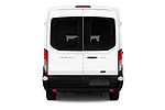 Straight rear view of a 2019 Ford Transit Wagon 150 XLT Wagon Med Roof Sliding Pass. 130 5 Door Passenger Van stock images