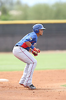Jose Almonte (4) of the AZL Rangers leads off of second base during a game against the AZL Padres at the San Diego Padres Spring Training Complex on July 4, 2015 in Peoria, Arizona. Padres defeated the Rangers, 9-2. (Larry Goren/Four Seam Images)