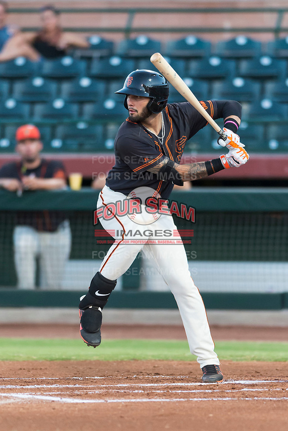 AZL Giants Black designated hitter Frankie Tostado (10) at bat during an Arizona League game against the AZL Rangers at Scottsdale Stadium on August 4, 2018 in Scottsdale, Arizona. The AZL Giants Black defeated the AZL Rangers by a score of 6-3 in the second game of a doubleheader. (Zachary Lucy/Four Seam Images)