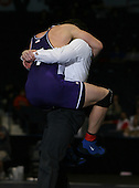 Robert Eskander (V) and Paul Glover (V) square off in the NY State Division One finals at the 215 weight class during the NY State Wrestling Championship finals at Blue Cross Arena on March 9, 2009 in Rochester, New York.  (Copyright Mike Janes Photography)
