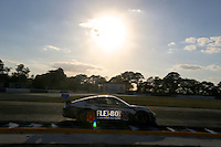 #44 Porsche of Andy Lally, John Potter, and Marco Seefired at Sunset, the 12 Hours of Sebring, Sebring International Raceway, Sebring, FL, March 2014.  (Photo by Brian Cleary/www.bcpix.com)