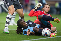 Marcus Bean of Wycombe Wanderers struggles to keep the ball in play during the Capital One Cup match between Wycombe Wanderers and Fulham at Adams Park, High Wycombe, England on 11 August 2015. Photo by Andy Rowland.