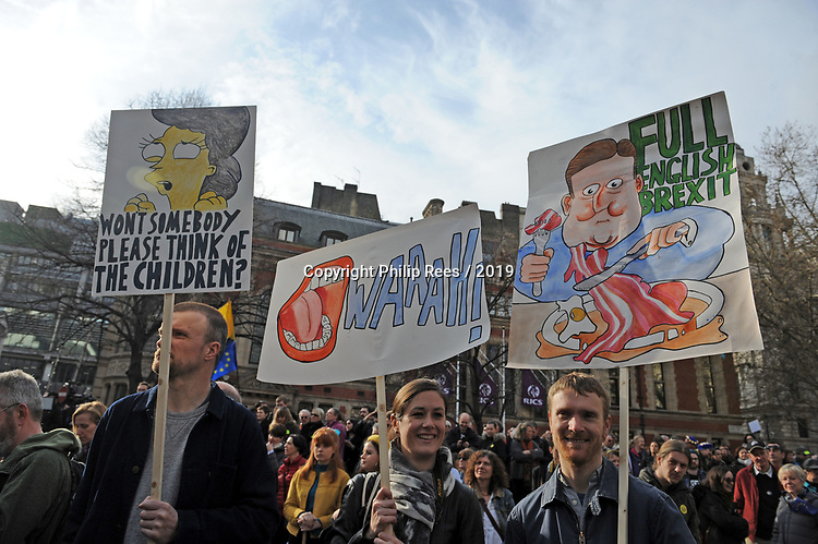 """Protestors with placards in Parliament Square during the """"Put it to the People"""" rally which made it's way through central London today. Demonstrators from across the country gathered to call for a second referendum on Brexit and to march through the UK capital finishing with speeches in Parliament Square opposite the Houses of Parliament in Westminster."""