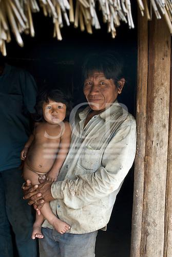 Mato Grosso State, Brazil. Aldeia Kenpo (Kayapo). Kiabiati Metuktire with his son.
