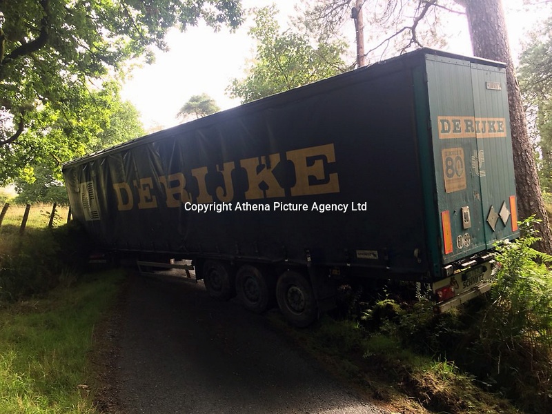 Pictured: The lorry which blocked off a road for over a day near Llanddewi Brefi, Wales, UK.<br /> Re: A lorry driver who was three times over the drink-drive limit was sentenced to 12 months in prison within a day of his arrest.<br /> Dyfed-Powys Police received reports of a lorry driving recklessly through Llanddewi Brefi shortly before 11am on Monday (August 20, 2018). The 44 tonne vehicle collided with a car and hedges before becoming stuck at an unclassified road - known locally as Hostel Road - blocking it completely.<br /> The driver was arrested with the help of local residents, who stayed with him while officers made their way to the scene.<br /> A 48-year-old foreign national, Ioan Sandu, blew three times the drink-drive limit (a reading of 105) in police custody and was charged with drink driving. He was yesterday (August 21, 2018) sentenced to 12 months in prison and banned from driving for 28 months.<br /> The road was closed until around 4pm (August 21, 2018).